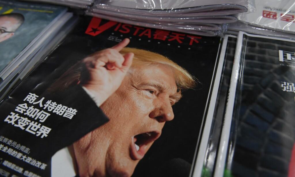 USIKKERHET: Hvordan vil forretningsmannen Trump forandre verden, spør denne magasin-forsiden i Beijing. Foto: AFP / NTB Scanpix