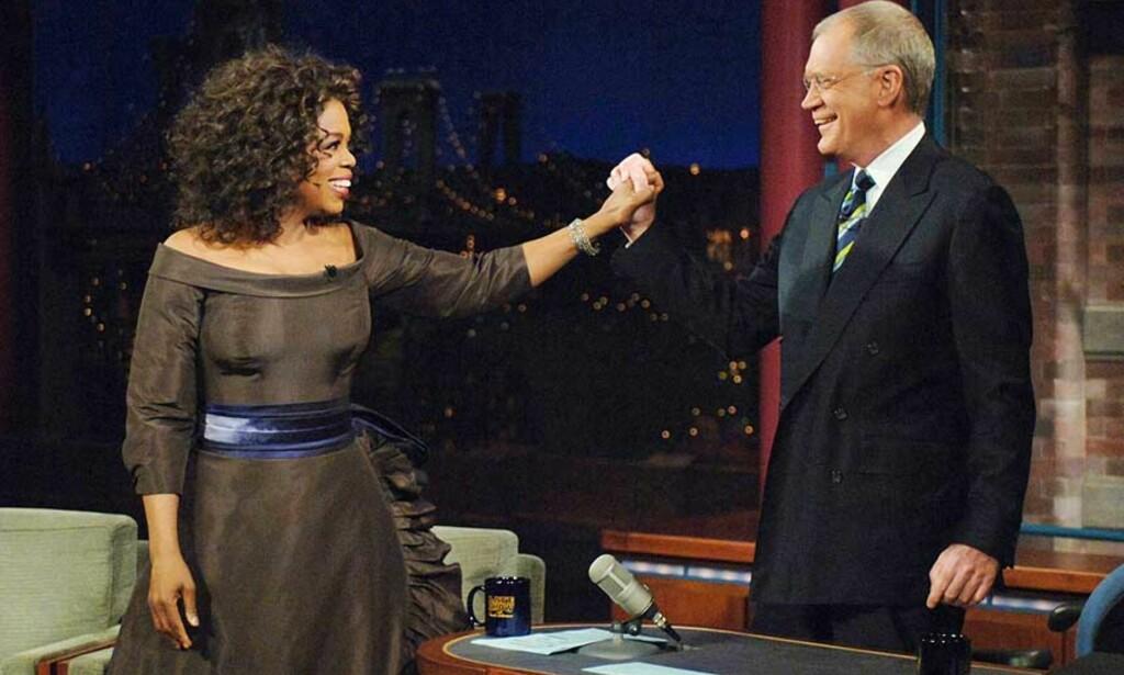 VENNER IGJEN: I går gjestet Oprah Winfrey «The Late Show» og David Letterman etter 16 års feide. Foto: Scanpix