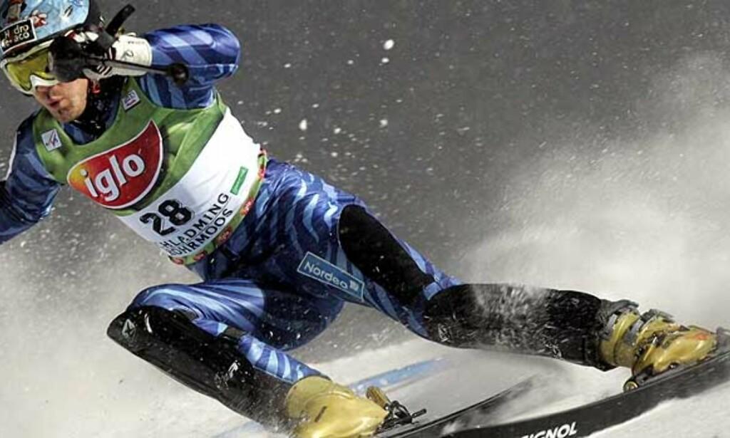 BURRE HAPPY: Hans Petter Buraas tok 20 verdenscuppoeng i italienske Madonna Di Campiglio i dag. Bildet er fra Schladming i januar i år. Foto: Scanpix
