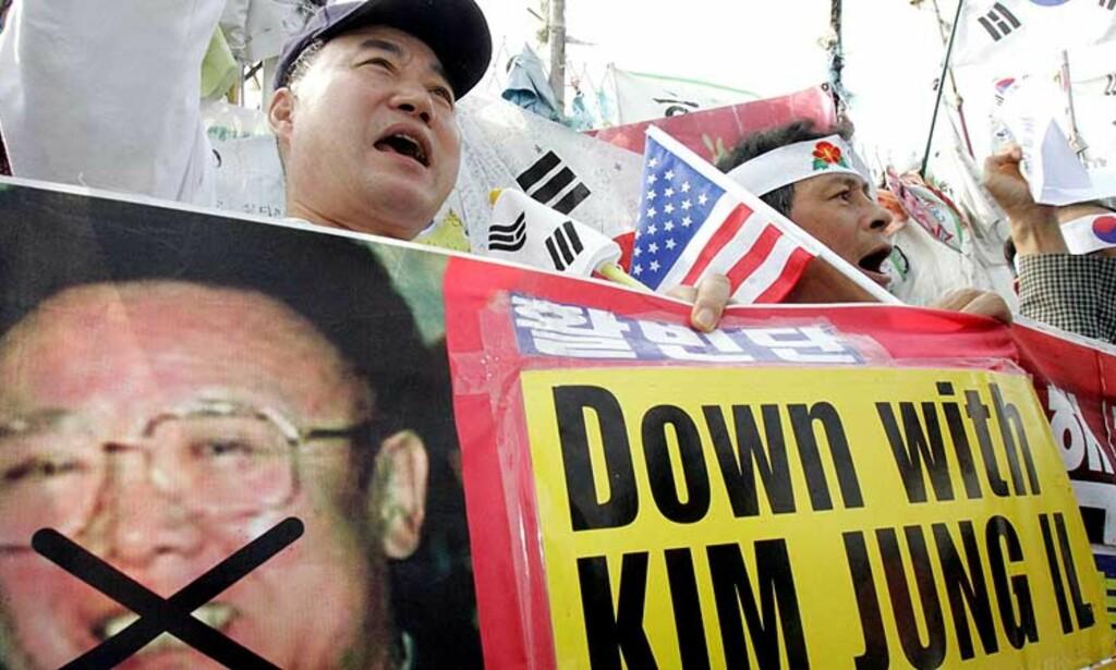 DEMONSTRASJON mot Kim Jong-Il og åtomvåpen i Sør-Korea i dag Foto: SCANPIX/AP