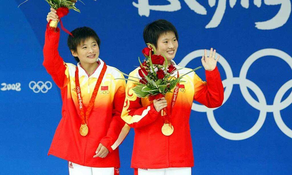 PURUNGE MEDALJER: 16-årige Wang Xin (fødselsdag i går) og 15-årige Chen Ruolin er to nye eksempler på en syk toppidrett som trenger all mulig oppmerksomhet for å bli frisk igjen, skriver Esten O. Sæther. Foto: AP/SCANPIX