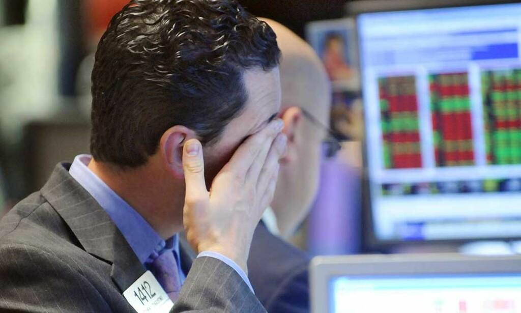 OPP OG NED: Det ble vinglete på Wall Street i dag. Foto: AP/SCANPIX