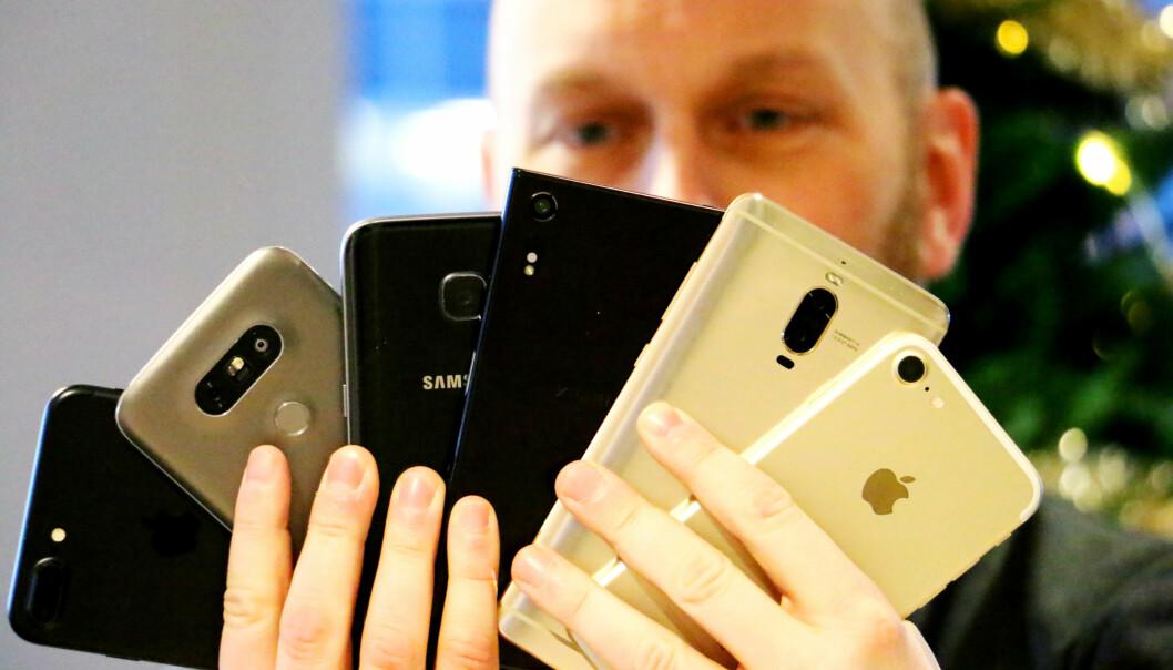 <strong>SEKS KANDIDATER:</strong> Vi har testet kameraet i toppmodellene fra Apple, Huawei, LG, Samsung og Sony. Foto: Andreas Heen Carlsen