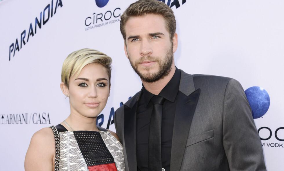 MANN OG KONE: Miley Cyrus og Liam Hemsworth ble forlovet for første gang i 2012. Nå skal de ha blitt mann og kone ifølge New Weekly Magazine. Foto: Scanpix
