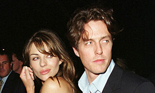 LON06:LONDON,23MAY00 - FILE PHOTO 2AUG99 -  Liz Hurley and Hugh Grant stop to be photographed as they arrive at a New York launch party in August 1999.  The celebrity couple announced, May 23, that they have decided to 'temporarily split up'.            br/Photo by Brad Rickerby     REUTERS