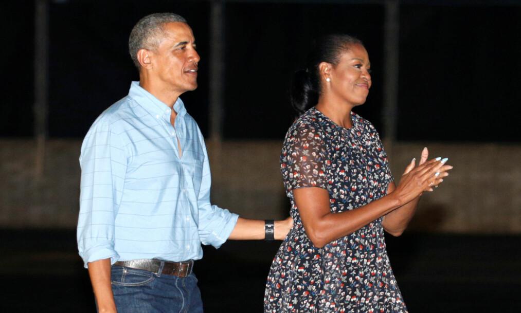 INGEN DRESS: Barack Obama og Michelle Obama besøker Pearl Harbor-krigsbasen på Oahu i Hawaii i begynnelsen av januar. REUTERS / Kevin Lamarque / NTB Scanpix