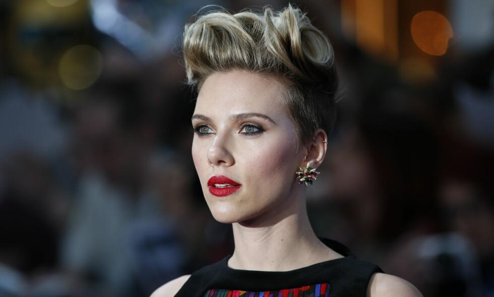 NYSKILT: Den ellers så private Scarlett Johansson (32) snakker åpenhjertig om det ferske samlivsbruddet i et nytt intervju - og hvorfor hun ikke tror på ekteskapet. Foto: Justin Tallis / AFP / NTB Scanpix