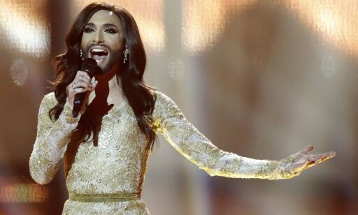 "FILE - In this May 10, 2014 file photo, singer Conchita Wurst, representing Austria, performs the song ""Rise Like a Phoenix"" during the final of the Eurovision Song Contest in the B&W Halls in Copenhagen, Denmark. Wurst, who won the competition, placed seventh on Google's list of 2014's fastest-rising global search requests, the company said Tuesday, Dec. 16, 2014. (AP Photo/Frank Augstein, File)"