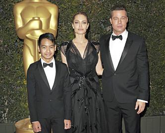 ADOPTERT: Stjerneparet Angelina og Brad adopterte flere barn i løpet av sitt ekteskap. Sønnen Maddox ble adoptert fra Kambodsja i 2002. Foto: NTB Scanpix.