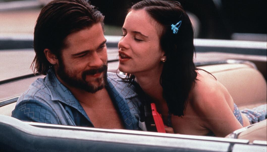 <strong>MOTSPILLERE:</strong> Brad Pitt og Juliette Lewis spilte i flere filmer sammen på starten av 1990-tallet. Her er de i en scene fra «Kalifornia: Passasjeren i baksetet». Foto: Mary Evans Picture/ NTB scanpix