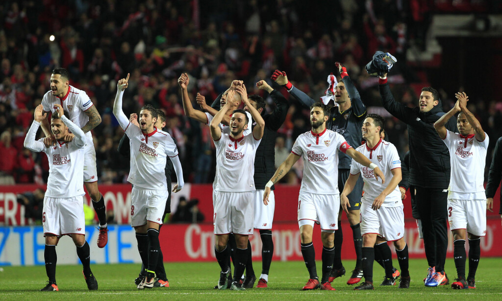 FILE - In this Jan. 15, 2017 file photo, Sevilla's players celebrate after winning their La Liga soccer match against Real Madrid at the Ramon Sanchez Pizjuan stadium, in Seville, Spain. Sevilla's much-improved defense could be key in its attempt to finally succeed in the Champions League with the Spanish club to take an important step toward establishing itself as a top contender in European football. Sevilla hosts Leicester in the first leg of the Round of 16 of the Champions League on Wednesday, Feb. 22. (AP Photo/Angel Fernandez, File)