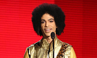 "FILE - In this Nov. 22, 2015 file photo, Prince presents the award for favorite album - soul/R&B at the American Music Awards in Los Angeles. A famous bassist and longtime friend of pop megastar Prince says the artist found ""real happiness"" in his faith and could stay up all night talking about the Bible. Larry Graham tells The Associated Press that Prince became a Jehovah's Witness later in life and that it changed the star's music and lifestyle. (Photo by Matt Sayles/Invision/AP, File)"