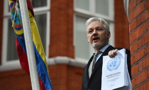 (FILES) This file photo taken on February 5, 2016 shows WikiLeaks founder Julian Assange addresses the media holding a printed report of the judgement of the UN's Working Group on Arbitrary Detention on his case from the balcony of the Ecuadorian embassy in central London. Swedish prosecutors investigating rape accusations against WikiLeaks founder Julian Assange must decide on May 19, 2017 if they will lift a European-wide arrest warrant against him in a seven-year case.  / AFP PHOTO / BEN STANSALL