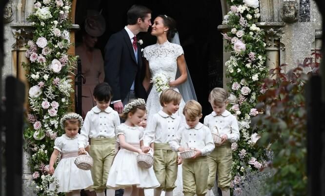 <strong>VAKKERT:</strong> Prinsesse Charlotte var brudepike og prins George var ringbærer da tanten, Pippa Middleton, giftet seg med James Matthews i mai i fjor. Foto: AFP Photo / NTB scanpix