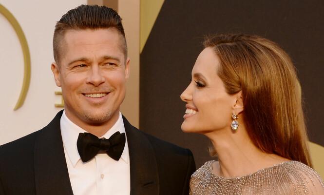 Brad Pitt og Angelina Jolie var kjærester i en årrekke, før de ga hverandre sitt ja i Her avbildet sammen i 2014. Foto: NTB Scanpix