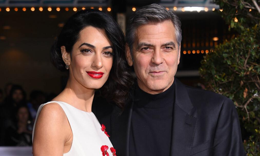 DONERER PENGER: Skuespiller George Clooney har sammen med kona, menneskerettighetsadvokaten Amal, donert hele åtte millioner kroner. Foto: NTB scanpix