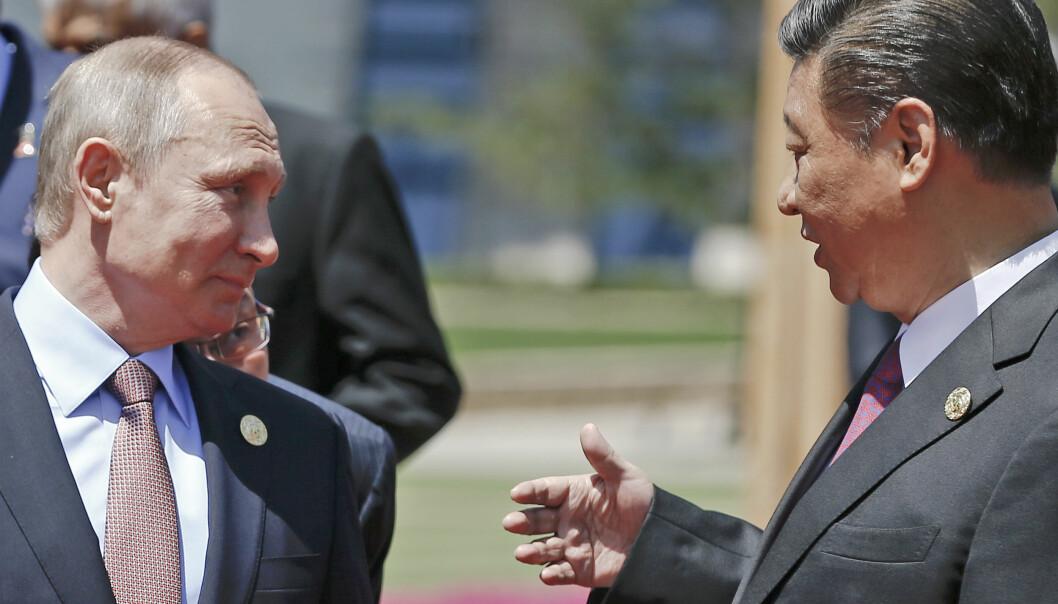 MØTES I MIDTEN: Kinas president Xi Jinping og Russlands president Vladimir Putin møtes i Sentral-Asia. Foto AP / NTB / Scanpix