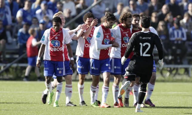 EKEBERG-JUBEL: Stian Sortevik (til høyre) sendte KFUM opp i 1-0, men Fredrik Brustad snudde for Molde med to scoringer. Foto: Berit Roald / NTB scanpix