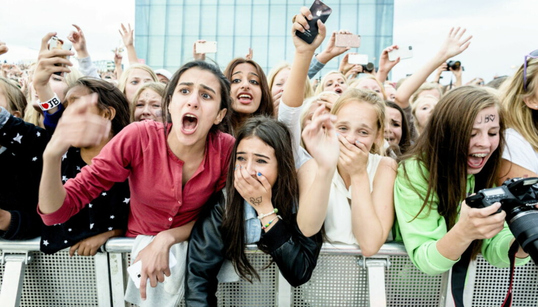 HYSTERISK: Fansen var hysteriske etter å se deres store idol, Justin Bieber, på scenen på operataket i Oslo i 2012. Foto: NTB Scanpix