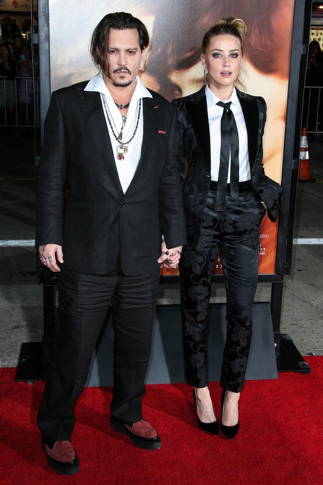 <strong>MATCHET:</strong> Skuespillerparet Johnny Depp og Amber Heard så smashing ut på premieren av «The Danish Girl» i Westwood i Los Angeles 21. november. Foto: NTB Scanpix