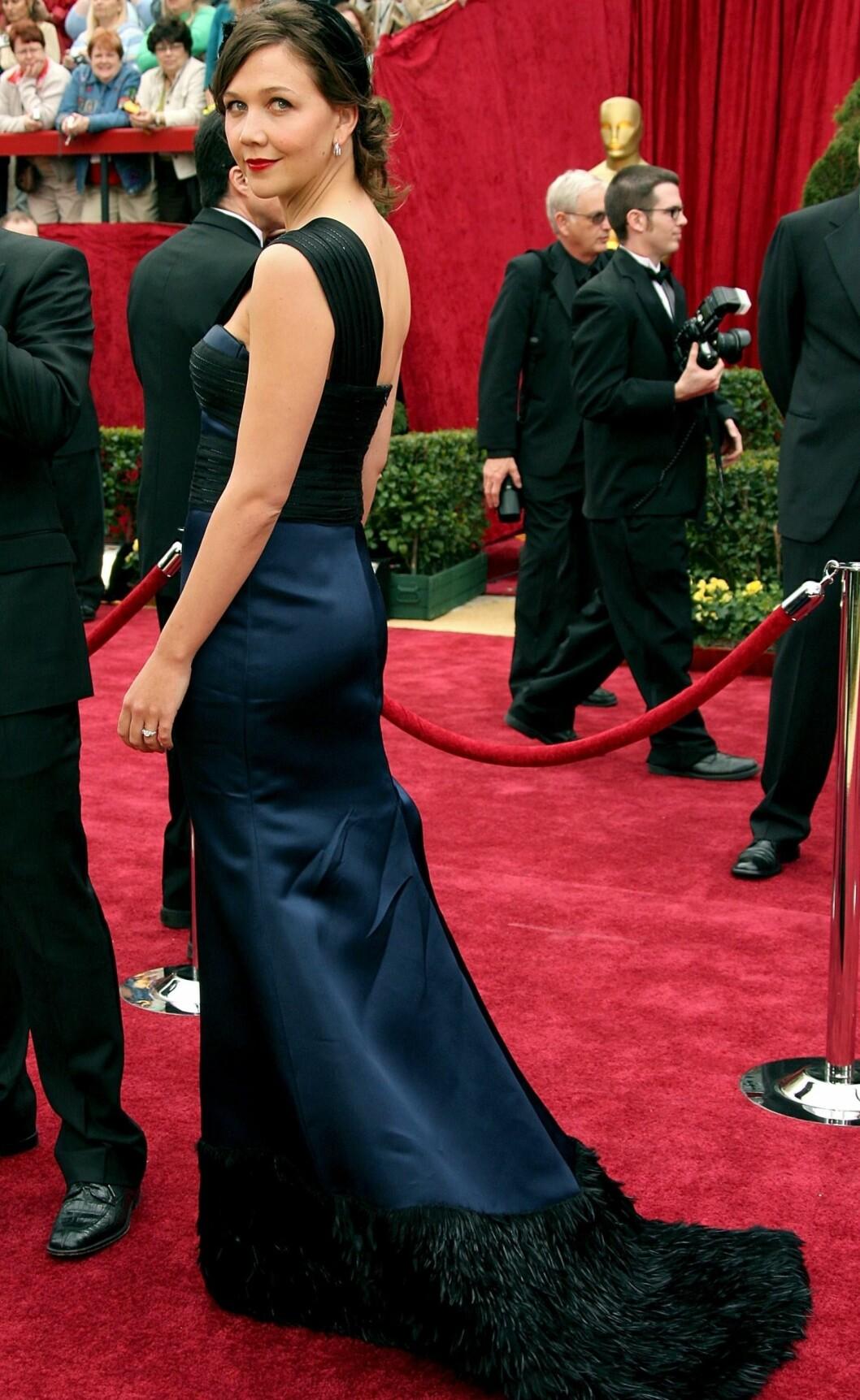 På Oscar-utdelingen i 2007 kom Maggie i en fotsid havfruekjole med slep av fjær. Foto: All Over Press