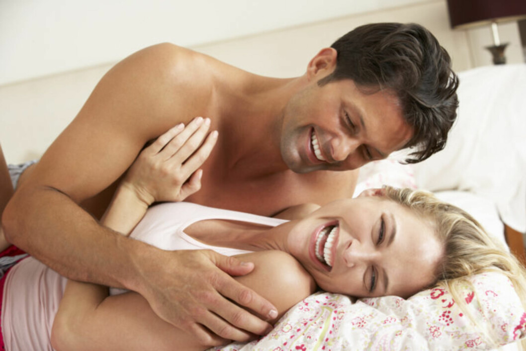 Couple Relaxing Together In Bed