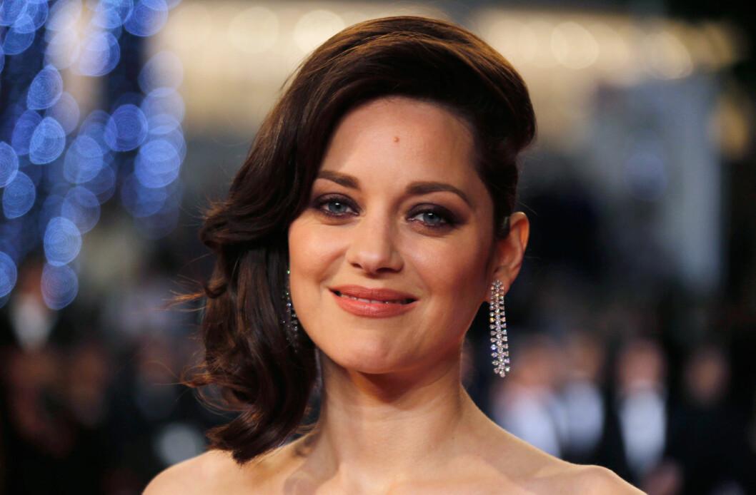<strong>SNAKKER UT:</strong> Etter bruddet mellom Angelina Jolie (41) og Brad Pitt (52), har ryktene svirret om at Pitt har hatt et affære med skuespilleren Marion Cotillard (40). Nå avkrefter Cotillard ryktene og røper at hun er gravid med sin ektemann.  Foto: Reuters