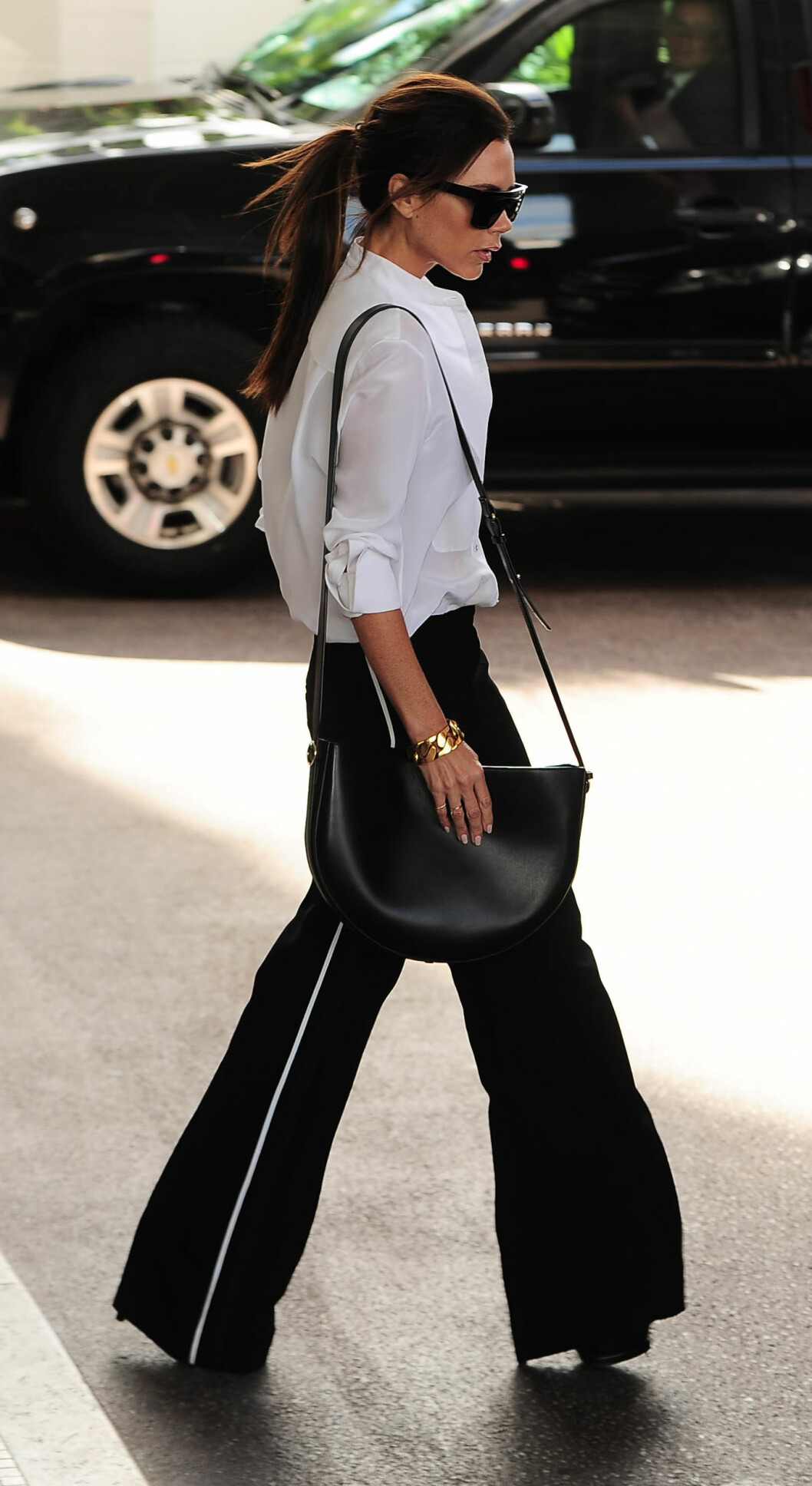 <strong>I KJENT STIL:</strong> Antrekk som dette er noe vi ofte ser Victoria Beckham i. Foto: Xposure