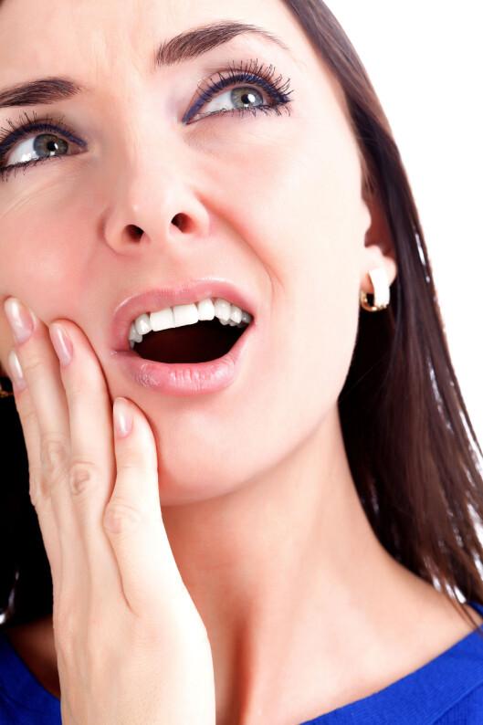 TYPISK TANNPINE: Siden visdomstennene sitter lengst bak i munnen kan det være vanskelig å pusse dem ordentlig. Foto: Fotolia