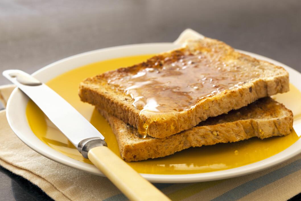 <strong>HONNING:</strong> - De absolutt mest usunne påleggene vil jeg si er sirup og honning – dette er kun sukker, sier ernæringsekspert Lise von Krogh til KK.no.  Foto: robynmac - Fotolia