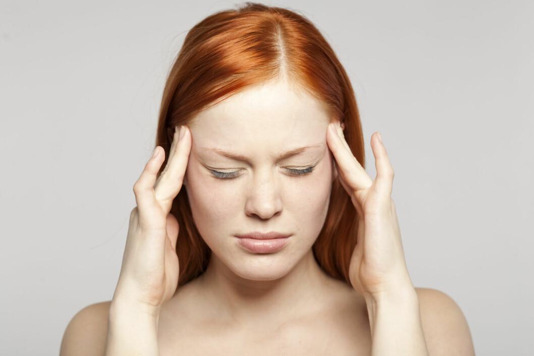 SMERTE: Vet du hva som er den vanligste årsaken til hodepine? Foto: Scanpix