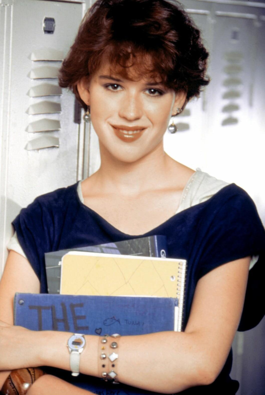 I SIXTEEN CANDLES FRA 1984: Molly Ringwald i filmen hun slo gjennom i. Foto: ©MCA/Courtesy Everett Collectio