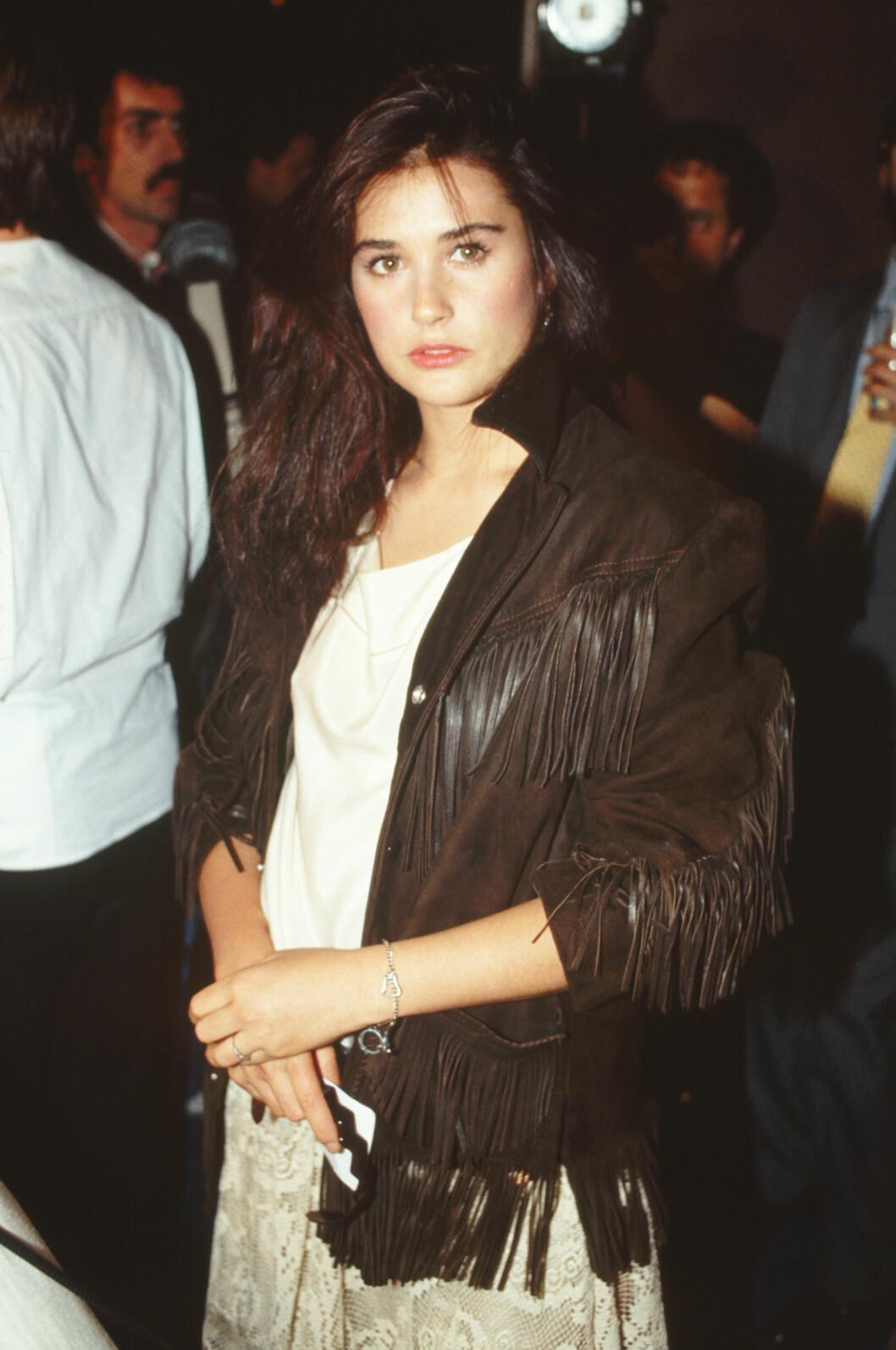 Demi Moore i 1985, i en oversized skinnjakke med frynser som det nok var svært mange som drømte om å ha. Foto: (c) CORBIS/All Over Press