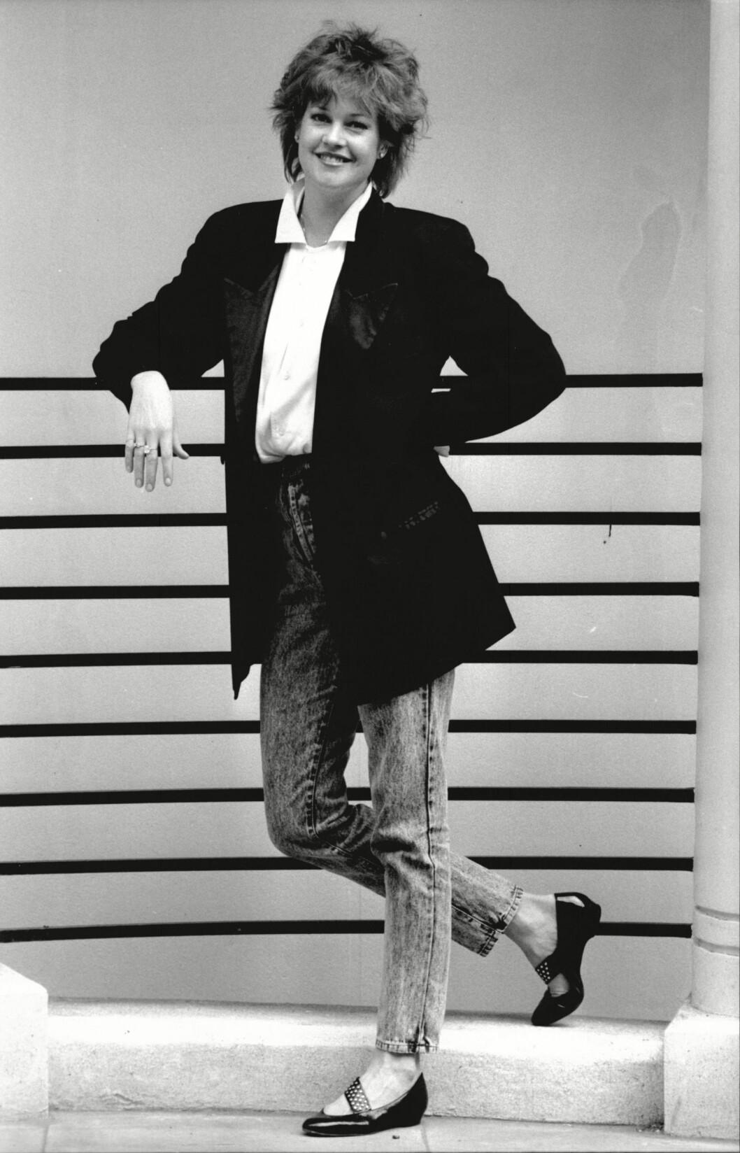 HERLIG STIL: Skuespiller Melanie Griffith i et topp hverdagsnatrekk fra 80-tallet, da steinvaskede jeans var den nye dressbuksen. Foto: REX/David Crump / Associated New