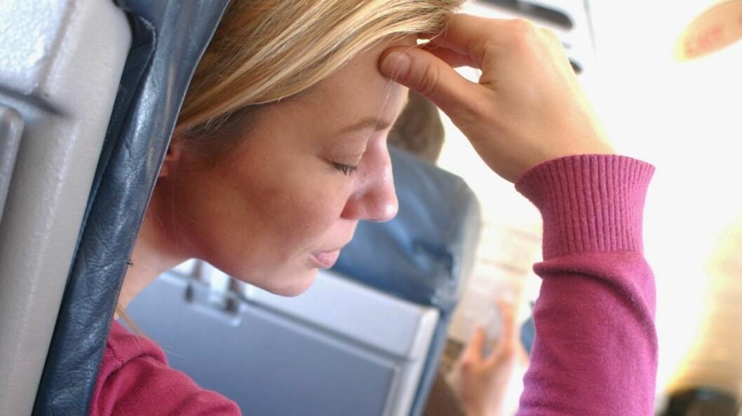 SMITTEFARE: Å bli syk på feriereisen din er noe de fleste helst vil unngå. Men når vi samles på steder med mye mennesker er vi særlig utsatt for smitte. Som for eksempel på et fly.  Foto: REX/Burger/Phanie/All Over Press
