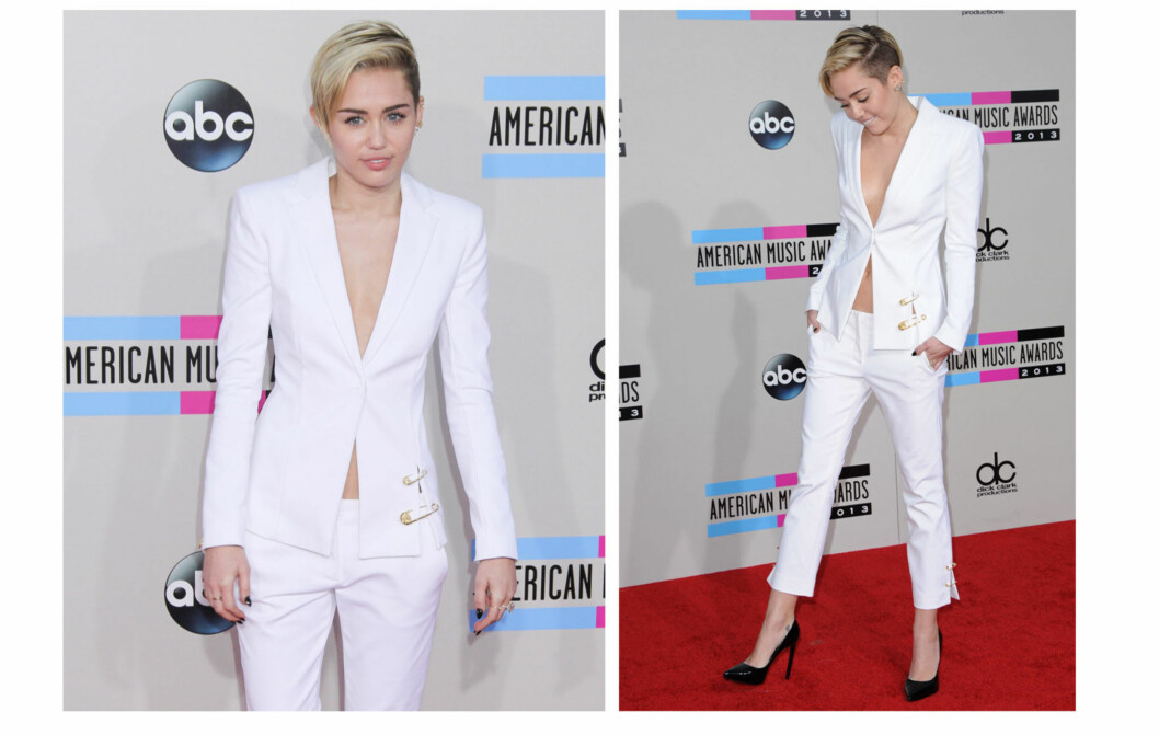 LEKKER I HVITT: Miley Cyrus hadde valt en hvit buksedress med svarte pumps og matchende negler på American Music Awards.  Foto: All Over Press
