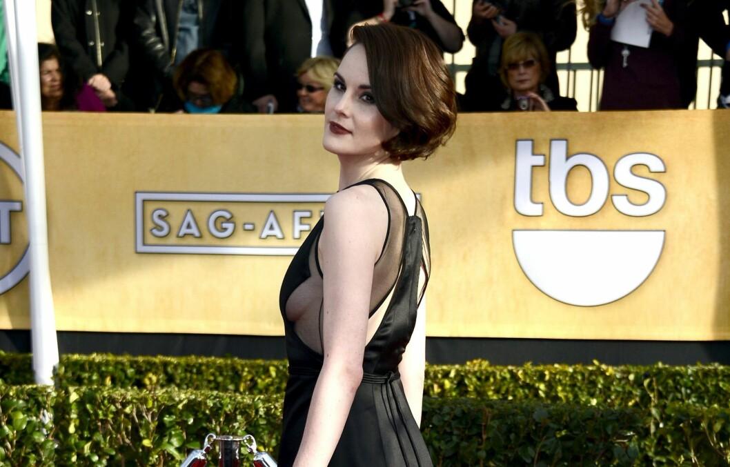 <strong>DRISTIG:</strong> Downton Abbey-stjerne Michelle Dockery bar en av kveldens mer vågale kjoler, under søndagens Screen Actors Guild Awards i LA.  Foto: All Over Press