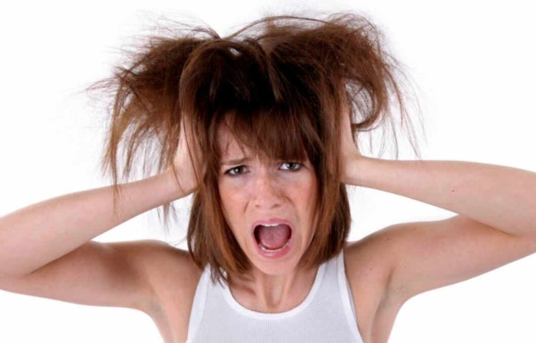 TØRT HÅR: Mange kvinner opplever at håret deres blir tørt spesilet i vintermånedene. Foto: Thinkstock
