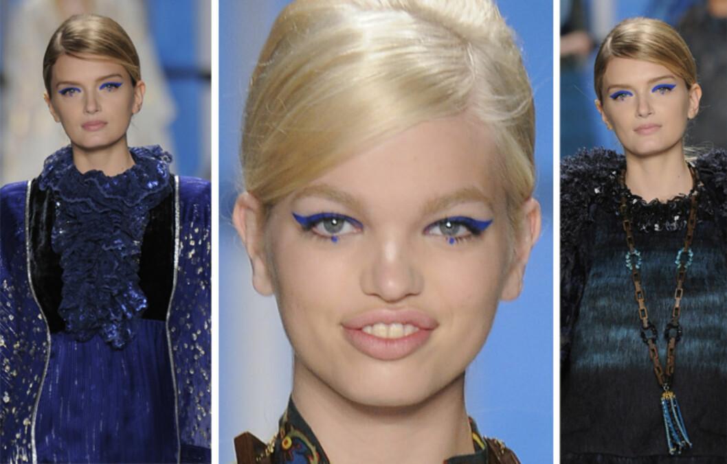DRAMATISK: En kraftig, vinget eyeliner i kongeblått er statement nok i seg selv, men Anna Sui valgte å fullføre looken med en blå prikk midt under øyet i tillegg.  Foto: All Over Press