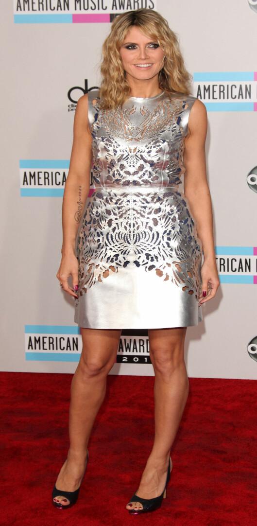 GREIT - DAMA ER SUPERMODELL. Vi forventer ikke av noen at de skal se ut som Heidi Klum når de får på seg partykjolen, men det betyr jo ikke at det ikke kan være verdt å prøve tipsene hennes. Foto: All Over Press