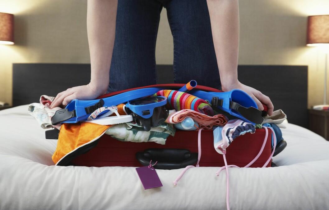 TRENGER DU 28 ANTREKK? Husk å planlegge nøye før du pakker. Du vil vel ikke fylle kofferten opp med antrekk du ikke kommer til å bruke? Foto: All Over Press