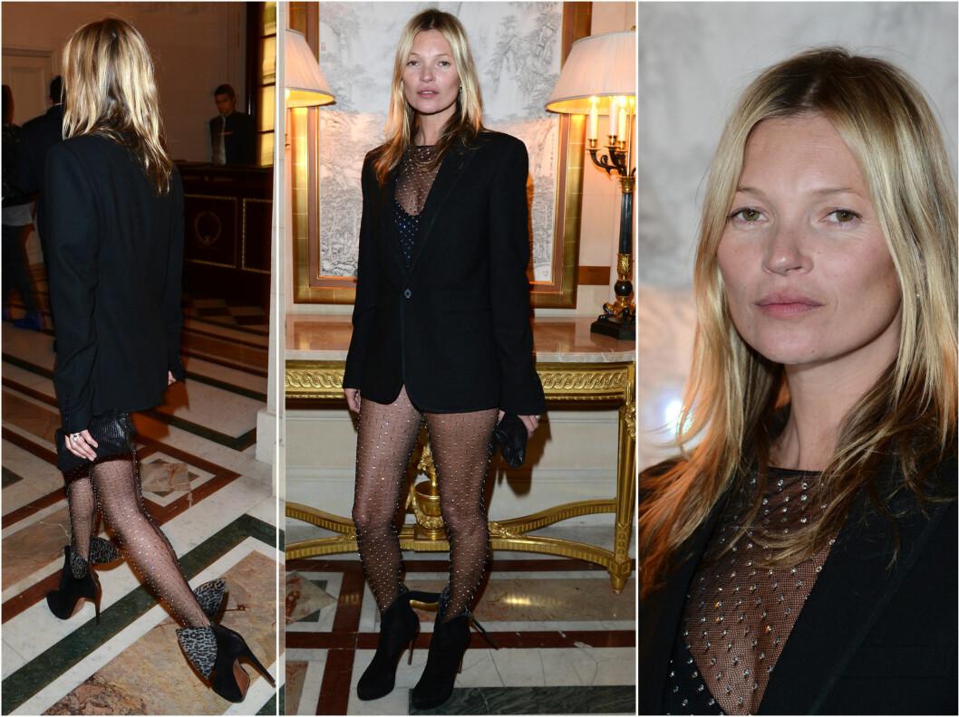 SMINKEFRI OG LETTKLEDD: Vakre Kate Moss vakte oppsikt under Paris Fashion Week. Foto: All Over Press