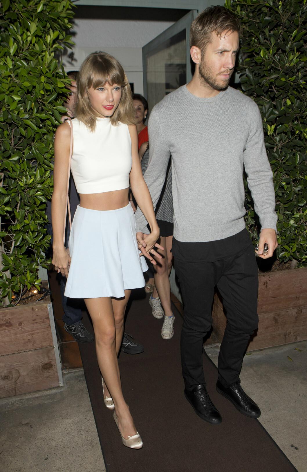 <strong>BRUDD:</strong> Etter bare 15 måneder tok forholdet mellom sanger Taylor Swift og DJ'en Calvin Harris slutt i juni. Foto: NTB Scanpix