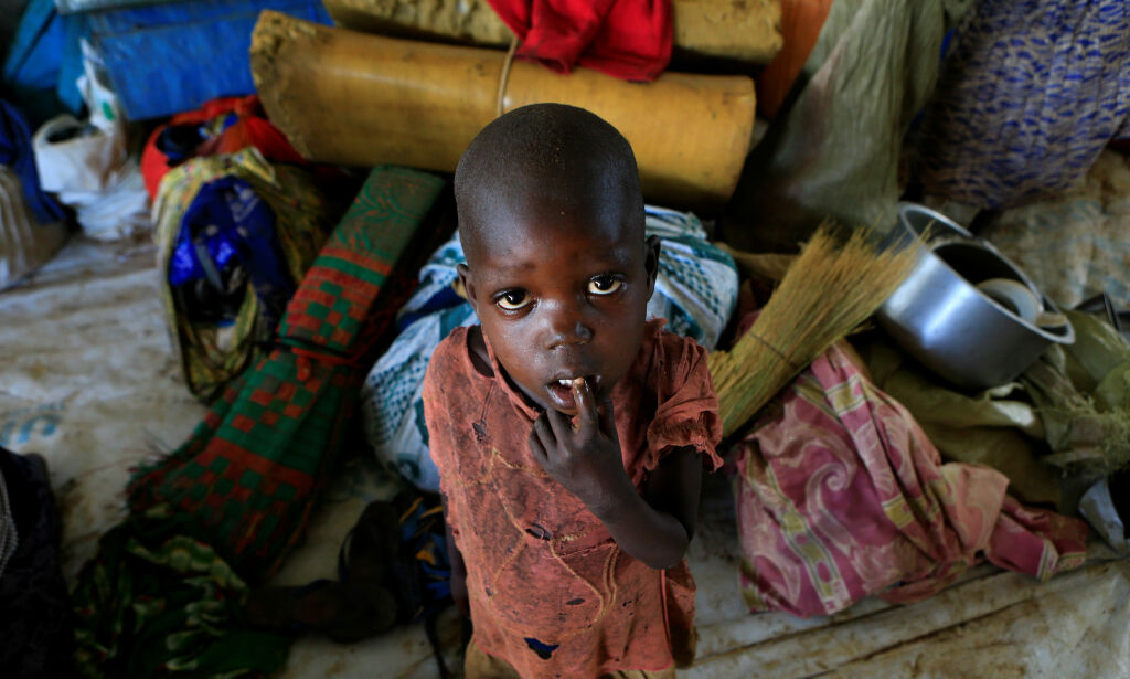 A displaced boy from South Sudan stands next to family belongings in Lamwo after fleeing fighting in Pajok town across the border in northern Uganda April 5, 2017. REUTERS/James Akena TPX IMAGES OF THE DAY