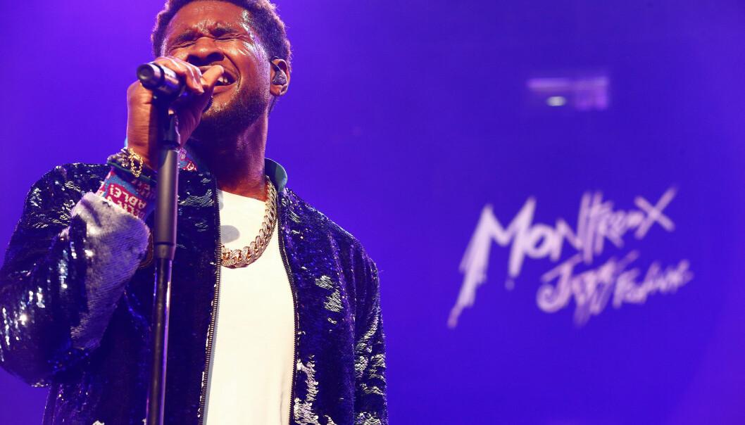 OPPTREDEN: Usher avbildet under Montreux Jazz Festival in Montreux i begynnelsen av juli. Han ble backet av bandet The Roots. Foto: Pierre Albouy / NTB scanpix