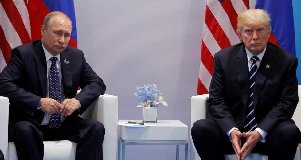 TRAFF HVERANDRE I HAMBURG: Vladimir Putin og Donald Trump. Foto: REUTERS/Carlos Barria/NTB Scanpix