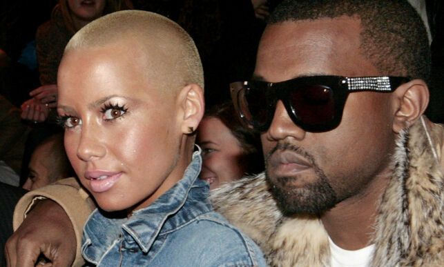 U.S. performer Kanye West, right, and Amber Rose, left, attend Belgian designer Kris Van Assche's collection for Dior, during the presentation of his Men's Fall-Winter 2010-2011 collection, in Paris, Saturday, Jan. 23, 2010. (AP Photo/Jacques Brinon)