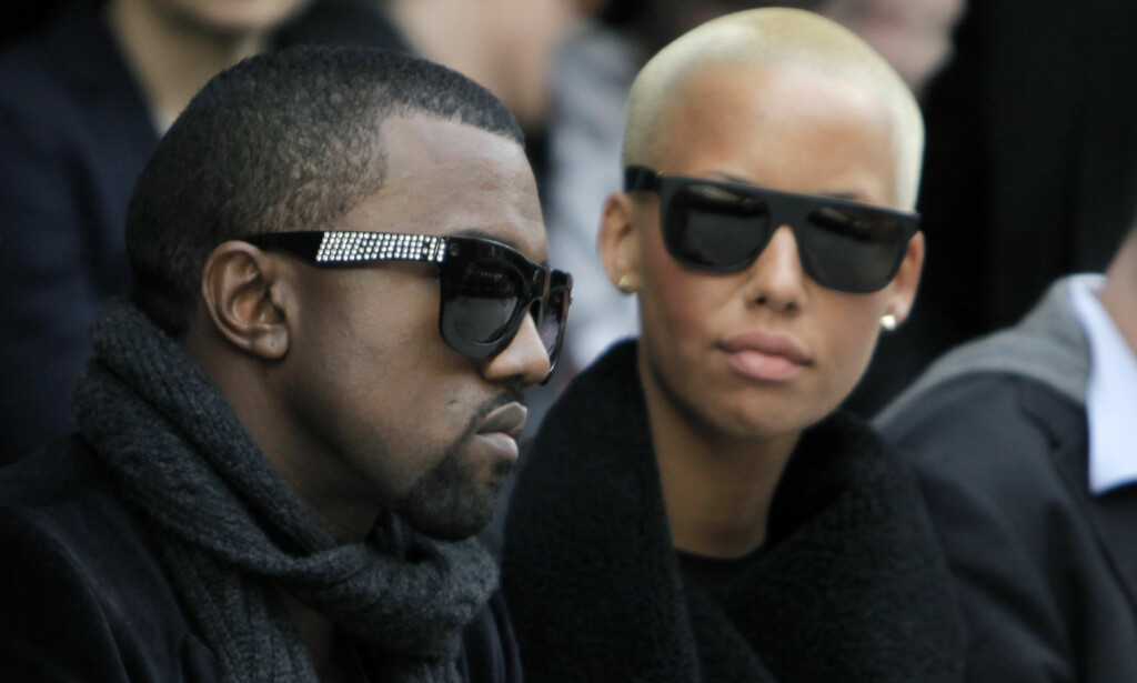 PROFILERT PAR: Kanye West og Amber Rose fotografert sammen på en motevisning i Paris i januar 2010. De siste åra er det Kim Kardashian som har sittet ved siden av West på første rad under diverse moteuker. Foto: AP/ NTB scanpix