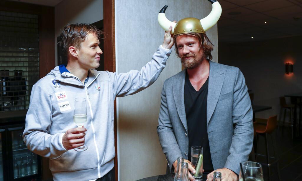 SAMARBEID: Med Andreas Thorkildsen og mange dyktige menn i ryggen har Karsten Warholm oppnådd underverker på friidrettsarenaen. Foto: Heiko Junge / NTB scanpix