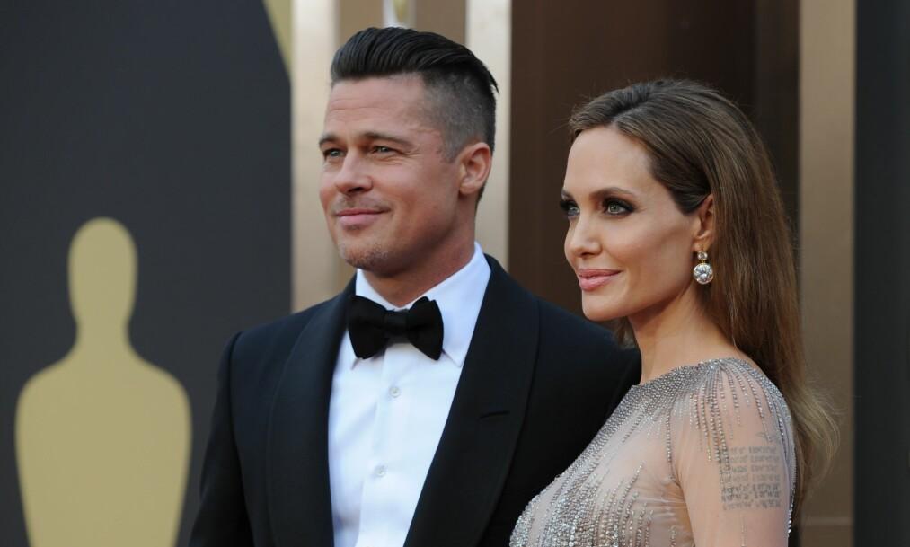 <strong>SKILSMISSE PÅ VENT:</strong> Angelina Jolie og Brad Pitt sjokkerte en hel verden da de i fjor delte nyheten om at de skulle skilles. Nå har stjerneparet derimot satt prosesen på vent. Foto: AFP / NTB Scanpix